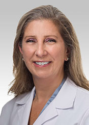 Ann Flores, PT,  PhD, CLT